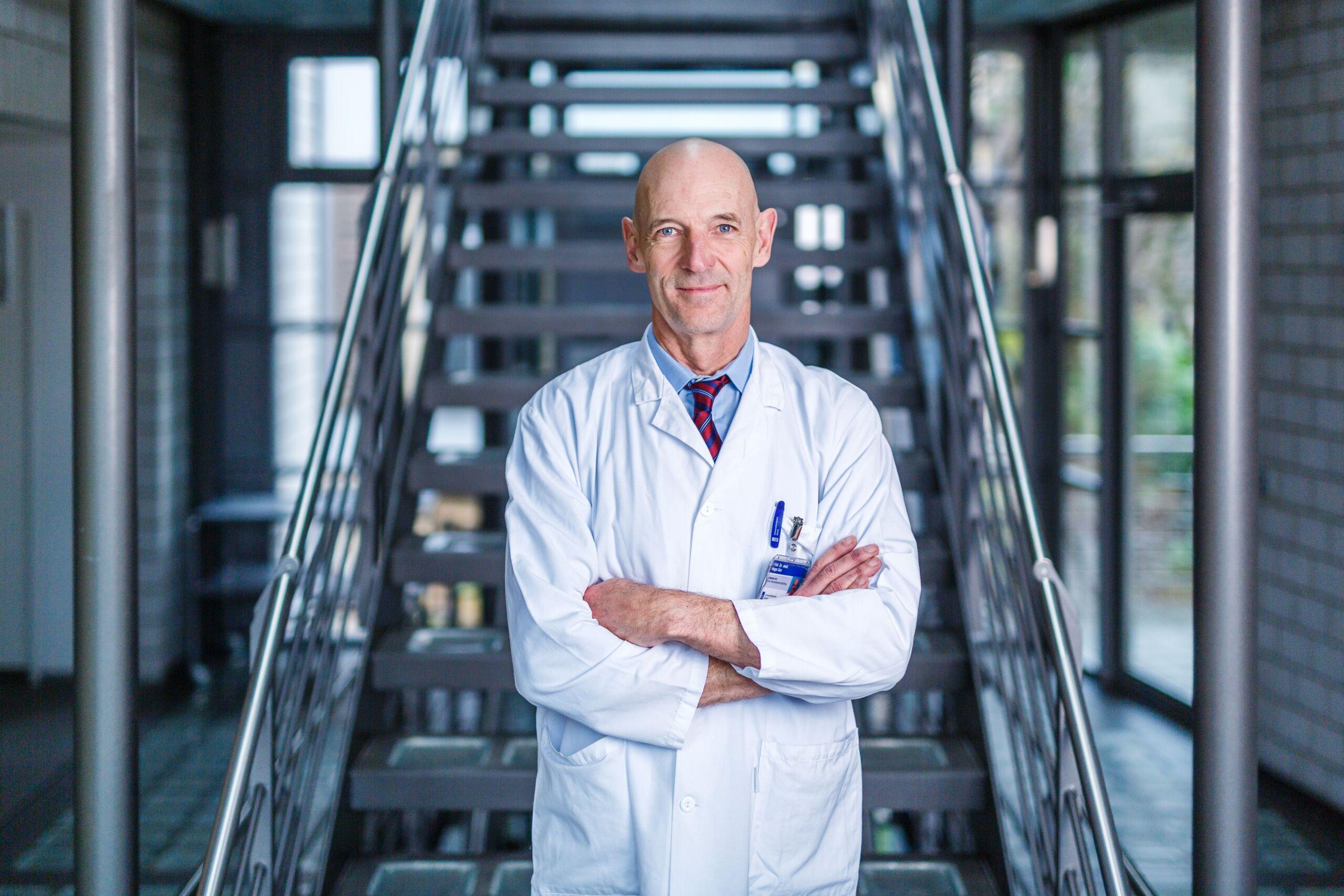 Arzt im weissen Kittel